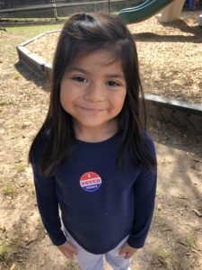 Girl with I Voted sticker